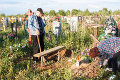 Perm, Russia - July 13. 2016: The man and the woman care of a tomb stock photo