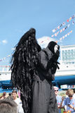 PERM, RUSSIA - JUN 15, 2013: Black angel on stilts. Million people visited Festival town White Nights in Perm 2013 Stock Photo