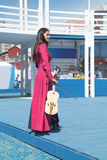 PERM, RUSSIA - JUN 11, 2013: Busker girl in long red dress Stock Images