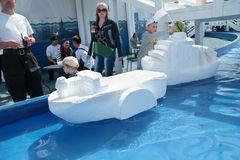 PERM, RUSSIA - JUN 15, 2013: Children with large styrofoam ships Stock Images