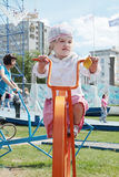 PERM, RUSSIA - JUN 15, 2013: Girl on unusual bike Royalty Free Stock Photo