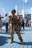 PERM, RUSSIA - JUN 15, 2013: Living sculpture golden Stock Photos