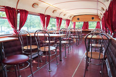 PERM, RUSSIA - JUN 11, 2013: Tables in double-decker bus cafe Stock Image