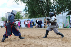 PERM, RUSSIA - JUNE 25, 2014: Fencer on left with two rapiers Royalty Free Stock Image