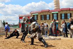 PERM, RUSSIA - JUNE 25, 2014: Two swordsman fighting with swords. On sand at festival White Nights Stock Photography