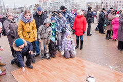 PERM, RUSSIA - March 13, 2016: Children ride on the linoleum Royalty Free Stock Photo