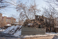 Perm, Russia - March 31.2016: Old ruined two-storey wooden house Stock Photography