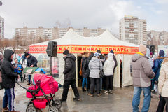 PERM, RUSSIA - March 13, 2016: People waiting in line for pancake Stock Photography