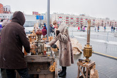 PERM, RUSSIA - March 13, 2016: Sales of hot tea from a samovar Royalty Free Stock Photo