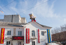 Perm, Russia - March 31.2016: Toy inflatable man on the roof of Stock Photography