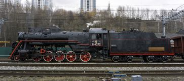 Functioning Soviet class L steam locomotive. Perm, Russia - May 09, 2018: functioning Soviet class L steam locomotive, on the shunting tracks of railway station stock image