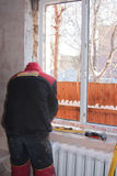 PERM, RUSSIA, NOVEMBER 19.2015:Installation of  plastic window Royalty Free Stock Photos