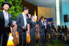 Permanent Fish vocals group in Tokyo. Tokyo, Japan - November 24 2013: Permanent Fish vocals group performs acappella at Tokyo Tower for the early preparation of Stock Photo