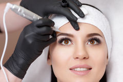 Permanent makeup. Tattooing of eyebrows Royalty Free Stock Photography