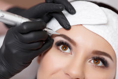 Permanent makeup. Tattooing of eyebrows Stock Images