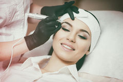 Permanent makeup. Tattooing of eyebrows. Permanent makeup. Permanent tattooing of eyebrows. Cosmetologist applying permanent make up on eyebrows- eyebrow tattoo stock image