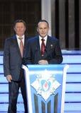 Permanent medlem av säkerhetsrådet från den ryska federationen Sergey Ivanov och provkosmonaut Sergey Ryazanskiy på ceremen Royaltyfria Bilder