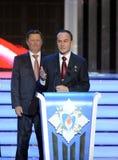 Permanent medlem av säkerhetsrådet från den ryska federationen Sergey Ivanov och provkosmonaut Sergey Ryazanskiy på ceremen Royaltyfri Foto