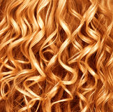 Permed red hair background. Curly ginger hair closeup. Permed red hair background Royalty Free Stock Photography