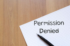 Permission denied write on notebook. Permission denied text concept write on notebook with pen Stock Photo