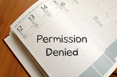 Permission denied write on notebook. Permission denied text concept write on notebook with pen Royalty Free Stock Photography