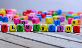 Permission word on table. Permission word on wooden table Stock Images