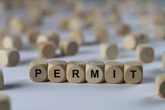 Permit - cube with letters, sign with wooden cubes Stock Image