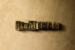 PERMITTED - close-up of grungy vintage typeset word on metal backdrop Stock Photography