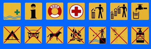Permitting and prohibiting signs on public beach Stock Images