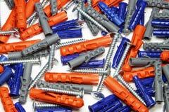 Perni blu e grigi arancioni con i auto-tappings Fotografia Stock