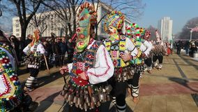 International Festival of Masquerade Games Surva in Pernik. Pernik, Bulgaria - January 27, 2018: People with mask called Kukeri dance and perform to scare the