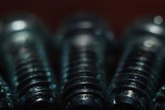 Perno de acero en el tiroteo macro máximo imagenes de archivo