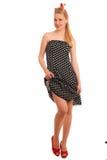 Perno retro del estilo encima de la muchacha con el pelo rubio en vestido negro con whi Imágenes de archivo libres de regalías