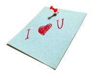 Perno rosso e un foglio di carta blu Immagini Stock