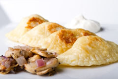 Perogies with mushrooms and sour cream Royalty Free Stock Photo