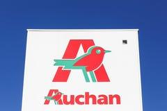 Auchan hypermarket logo on a signboard