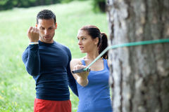 Personal trainer working with his client Stock Images