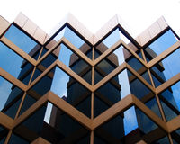 Perpendicular reflections. A building reflecting itself within its perpendicular architecture Stock Images