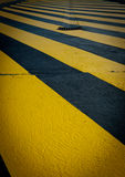 Perpendicular yellow pedestrian crossing Royalty Free Stock Images