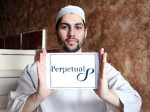 Perpetual Limited logo. Logo of Perpetual Limited on samsung tablet holded by arab muslim man. Perpetual is an Australian investment and trustee group providing stock photos