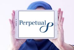 Perpetual Limited logo. Logo of Perpetual Limited on samsung tablet holded by arab muslim woman. Perpetual is an Australian investment and trustee group stock photo