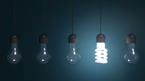 Perpetual motion with light bulbs and energy saver bulb.  Royalty Free Stock Photo