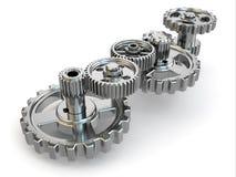 Perpetuum mobile. Ingranaggi del ferro su fondo bianco. Immagine Stock