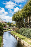 Perpignan. Picturesque view of Perpignan and its river in a sunny day. France Royalty Free Stock Photography