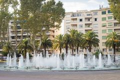 Perpignan France city centre water fountain jet palm trees Royalty Free Stock Images