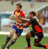 Perpignan's flanker Bertrand Guiry. Perpignan's flanker Guiry is tackled by Toulon's Gabiriele during the Heineken European Cup quarter-final match USAP Royalty Free Stock Photo