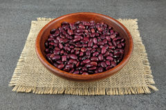 Perple dried beans in a wooden bowl. Royalty Free Stock Photography