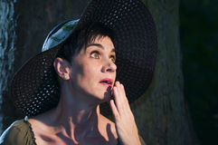 Perplex look of lady with hat Stock Images