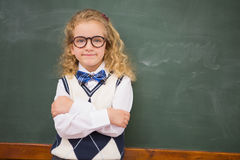 Perplex pupil looking at camera with arms crossed. At elementary school Royalty Free Stock Photos