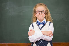 Perplex pupil looking at camera with arms crossed. At elementary school Royalty Free Stock Images